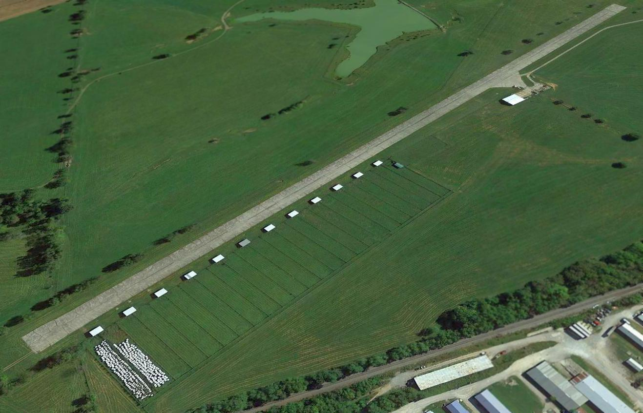 A 2014 aerial view looking northeast showed the Codell Field paved runway &  hangar remained intact.