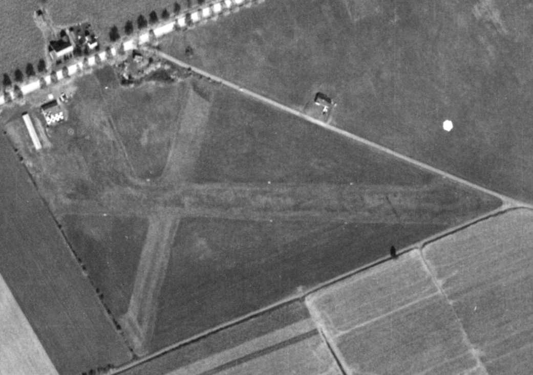 A 10/24/58 Aerial View (from Penn Pilot) Depicted Trexlertown Airport As  Having 2 Grass Runways, With A Checkerboard Roofed Hangar On The Northwest  Side.